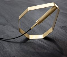 Pietro Russo's Otto design is an octagonal brass lamp that can be repositioned at three different angles.