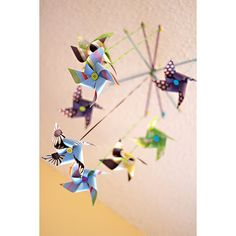 DIY Paper Pinwheel Mobile From Snippets.  craft-diy-paper-pinwheel-decor