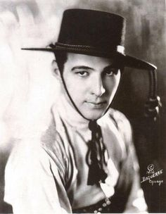 Silent film idol Rudolph Valentino, costumed as a Latin lover, 1926