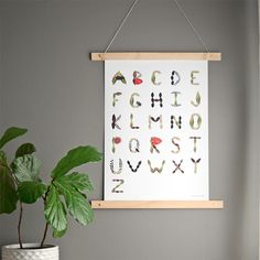 Tropical foliage is scanned to create this one of a kind alphabet chart.