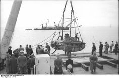 """France, the Channel coast, summer 1940: Preparations for """"Operation Sealion"""", the German invasion of Britain. German Army and Naval personnel observing trials of a submersible Panzer III tank being developed for the invasion of Britain."""