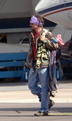 Johnny Depp has the right idea..why pack when you can wear it.  Love this man!! <3