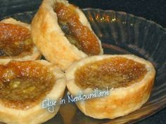 Real Canadian Butter Tarts Real Canadian Butter Tarts from : Melt in your mouth butter tarts, oh sooo good ! The method for baking is unusual, but will prevent the filling from boiling over. Köstliche Desserts, Delicious Desserts, Dessert Recipes, Yummy Food, Plated Desserts, Italian Desserts, Tart Recipes, Cooking Recipes, Yummy Recipes