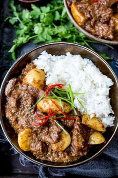 Slow Cooked Beef Massaman Curry - Rich, fall-apart beef in a spicy homemade sauce with new potatoes. Perfect comfort food!