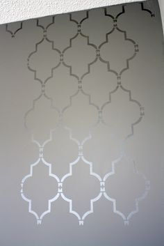 I want to do this in my bathroom! Stencil + metallic paint = beautiful wall pattern! No annoying wallpaper to deal with!