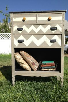 Gray and white chevron and striped dresser - salvaged an old dresser with broken drawers. Could do this in the living room and use the space for blankets and pillows. Love! Wouldn't do chevrons though, would just paint a simple peach or coral color. Put TV on top and a white bookcase on either side.