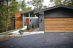 Midcentury exterior with dark gray and wood Sherwin Williams Urbane Bronze SW 7048 Benjamin Moore Titanium 2141-60