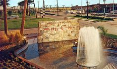 Welcome to Sun City in the Grand Avenue and Del Webb Boulevard Avenue), where the ghost town of Marinette had been. The view is looking south towards the Estrella Mountains. Sun City Arizona, Grand Homes, Enjoying The Sun, Ghost Towns, 1960s, Places To Visit, Mountains, Sixties Fashion, Bergen