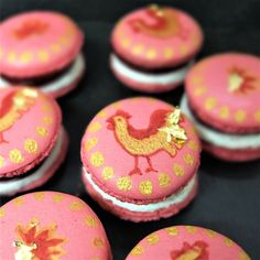 Raspberry-black-pepper-cheesecake-macarons decorated with lunar new year roosters! at liliscakes.com #raspberry #blackpepper slightly #savourymacarons #macarons #creamcheese #recipe