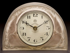 R. LALIQUE CLEAR AND FROSTED GLASS MOINEAUX CLOCK  Circa 1924  Molded: R. LALIQUE