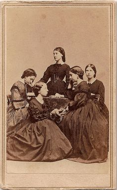 Knitting Circle by Piedmont Fossil, via Flickr. In this photo, dated December 6, 1862, a group of young women gather to make knit goods to be donated to the men in the army. A ball of yarn pierced by a knitting needle sits on the table and the woman in the lower left holds a skein of yarn on her arms. Meanwhile the woman at far left reads aloud to the others, probably to help pass the time as they work. Photograph by N. Ghiradini, Washington Gallery, Providence, Rhode Island.