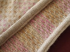 steek with a neat edge to form a sandwich around the cut stitch edges.