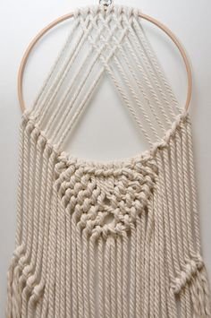 Ready to ship. Made with 100% macrame Cotton rope. This lovely macrame wall hanging is a great gift idea. This wall hanging made from 6 mm natural unbleached cotton rope The width is 11 inch (29 cm) Length 40 inch (102 cm) The colour of the yarn is ecru/beige. Please note - these are my