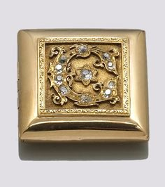A diamond and eighteen karat gold box  estimated total diamond weight: 1.30 carats; weighing approximately: 36.5 grams; dimensions: 1 9/16 x 1 1/2 x 1/2in.