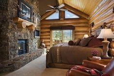 Dormitorio piedra y madera, colores claros tonos marrones.