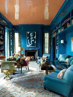 5. Salmon & Blue The first floor library in this Chicago townhouse feels both intimate and important. Designer Steven Gambrel's use of Rothko blue and salmon colors reflect the adventurous nature of the very stylish clients.See more of the home here >