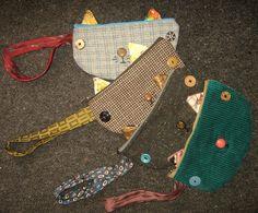 cat-face clutch purses by atticusfinchnz, via Flickr