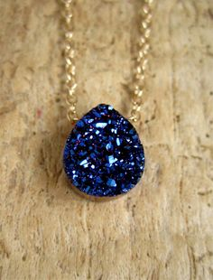 Intensely blue titanium druzy takes center stage along a delicate 14K gold filled cable chain. Natural, pear-shaped druzy stone measures