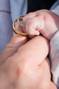 Little baby boy is wedding rings bearer.