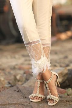 Ivory raw silk trousers with organza and feather lace styling on flare. Also available to order in black. Plazzo Pants, Salwar Pants, Fashion Pants, Fashion Dresses, Moda Outfits, Sleeves Designs For Dresses, Mode Jeans, Salwar Designs, Feather Dress