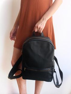 "MILAN, black backpack - Vegan leather backpack. This black backpack It's a very comfortable vegan leather backpack for everyday!  The bag is made of strong vegan leather and it's big enough to contain a binder or a notebook and also carry all your day must have's. The backpack made from vinyl that feel comfortable against your back and shoulders when you wear this bag.     Dimensions: Width: 10"" // 26cm Mid-height: 14.5"" // 37 cm Depth: 4"" // 10 cm Zipper Length: 18.8"" // 48 cm  Features…"