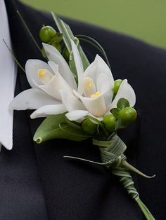 white mini cymbidium orchid wedding flower boutonniere, groom boutonniere, groom flowers, add pic source on comment and we will update it. www.myfloweraffair.com can create this beautiful wedding flower look.