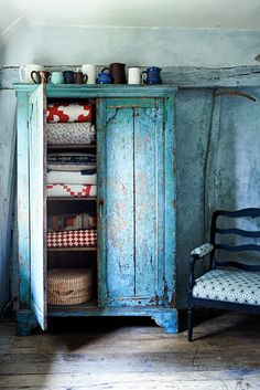 What could be better? A blue cabinet filled with quilts...