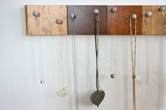 Necklace organization out of hardwood floor samples and bolts...no more tangled necklaces!