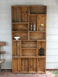 A bookcase made out of pallets.  We are going to make two of these, and already have our pile of pallets ready to go!
