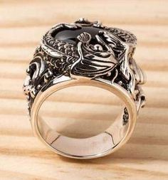 If you are looking for both spellbinding and meaningful accessory, our Onyx Sterling Silver Koi Gothic Ring is right up your street. It's made of solid silver Engagement Ring Prices, Celtic Engagement Rings, Gothic Engagement Ring, Unusual Engagement Rings, Celtic Wedding Rings, Classic Engagement Rings, Mens Sterling Silver Necklace, Mens Silver Rings, Onyx Necklace