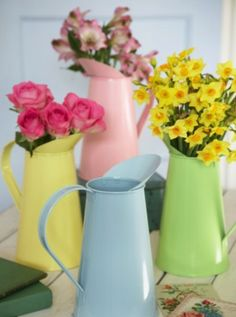 Metal Jugs by The Contempory Home, a great alternative to vases or for centre pieces.
