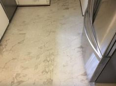 Trafficmaster Allure Ultra 12 In X 23 82 Carrara White Resilient Vinyl Tile Flooring With Simplefit End Joint 19 8 Sq Ft