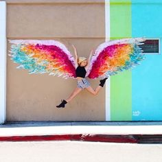 Rainbow Wings mural with girl jumping.   Follow me at www.instagram.com/laurie_somma
