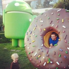 This child posing with a giant Droid: | 23 Things That Could Only Exist In Silicon Valley