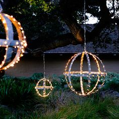 Create outdoor chandeliers by wrapping lights around old wine-barrel hoops, then suspending them from the branches of a large tree.