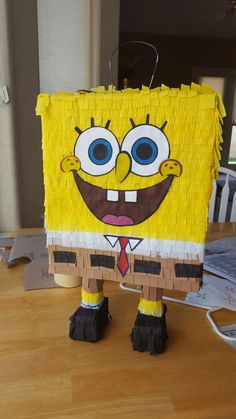 SpongeBob pinata for Spanish class.  paper mache over rice Krispy box, party streamers for decoration