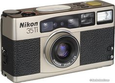 Nikon - A P Film Camera with a darn good lens on it. It's a fun one to shoot with and always garners some looks. Nikon Camera Models, Toy Camera, 35mm Camera, Camera Gear, Nikon Cameras, 35 Mm Lens, Pocket Camera, Classic Camera, Camera Obscura