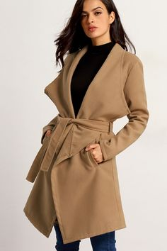 Structured with layers of chicness is what we give you in this camel colored lapel woolen coat. A wide lapel collar drapes to the front bodice, a waist band for an adjustable fit, then french side pockets for functionality.