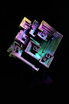 Bismuth (Man made crystal showing hopper growth pattern)