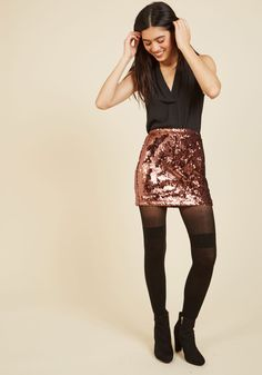 Shimmer Fling Mini Skirt | Mod Retro Vintage Skirts | ModCloth.com  Have a thing for sparkles? Then you'll love this sequin skirt! Rose gold in hue and matte in finish, the shimmers on this Motel mini will make you wild!
