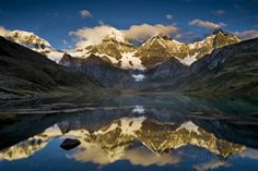 Mount Yerupaja Reflects in Lake Huayhuish, Andes Mountains, Peru ...