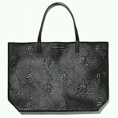 NWT Victoria's Secret laser cut tote NWT, perfect condition. Offers considered with the offer feature only, no trades. Victoria's Secret Bags Totes