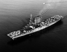 80-G-416362: USS Lexington (CV-2). Leaving San Diego, California, 14 October 1941. Planes parked on her flight deck include F2A-1 fighters (parked forward), SBD scout-bombers (amidships) and TBD-1 torpedo planes (aft). Note the false bow wave painted on her hull, forward, and badly chalked condition of the hull's camouflage paint. Official U.S. Navy Photograph, now in the collections of the National Archives. (2016/01/05).