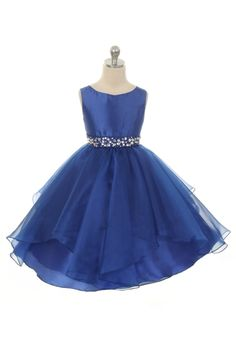 Perfect for any special occasion, this taffeta dress with organza ruffles is sure to make your little one shine! The waistline is embellished with rhinestones sewn in and the back ties with 2 sashes. Tea Length