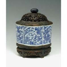 Chinese, Ming Dynasty (1368-1644), Wanli Reign (1573-1620)  Chinese   Foliated Deep Box with Wood Lid and Stand, 1573-1619  porcelain, blue and white on wood base