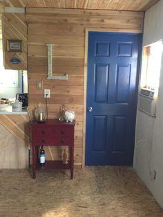 I love the blue door with the cedar walls