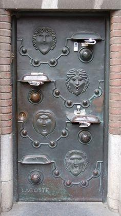 Interesting old doorbell / mail slot arrangement.