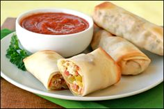 Pizza Egg Rolls  Ingredients: 3 sticks light string cheese  3/4 cup finely chopped mushrooms 1/2 cup finely chopped bell pepper 1/4 cup finely chopped onion 10 slices turkey pepperoni, finely chopped  4 large square egg roll wrappers  1/2 cup canned crushed tomatoes 1/2 tsp. garlic powder 1/4 tsp. Italian seasoning