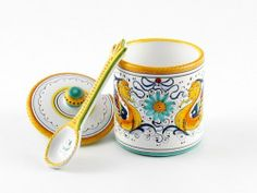 Hand Painted Italian Ceramic Jam Jar With Spoon Raffaellesco - Handmade in Deruta by thatsArte. $79.00. 100% food safe. Full range of dinnerware, serveware and kitchenware available. Handmade in Deruta, Italy. Signed by the artist. Free shipping for orders over $400. 3.3 x 3.5 x 4.7 inches. Ships from Italy with fully insured air service. Inspired by Renaissance frescoes painted by Raphael, Raffaellesco is the most popular among Deruta patterns. Although most pottery studios i...