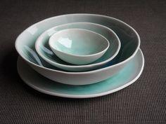 Porcelain bowls with turquoise glaze inside.Matt outside.